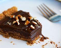 chocolate and peanut butter caramel tart with pretzel crust!