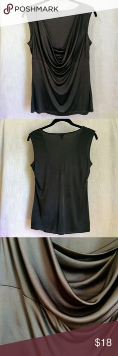 "Ann Taylor Cowl Neck Sleeveless Blouse Dark gray cowl neckline sleeveless blouse from Ann Taylor. Beautiful satin finish. In good condition with small snags in the back (see second closeup photo). Bust: 38"" Length: 25"" 100% Rayon. Dry clean recommended. Ann Taylor Tops Blouses"
