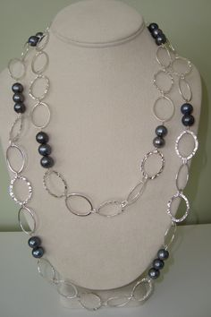 A long, fun chain necklace with peacock pearls! Wear it as one long necklace or double it up!