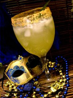 King Zulu - King Cake Vodka, pineapple, coconut, fresh lime, sparkling wine and gold sugar.