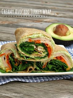 Tortillas wrap turkey slices, shredded carrot and spinach leaves, along with a creamy sauce made from avocado, Greek yogurt and garlic. Great lunch recipe.
