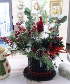 Only at White Squirrel Gifts A Snowman hat holds graceful floral stems, berries and holly to make his new year bright. A Santa Claus is tucked in neatly against all the flora and fauna. Pictures show. Snowman Hat, Snowmen, Reindeer, Christmas Wreaths, Christmas Tree, Tree Toppers, Xmas Decorations, Stems, Picture Show