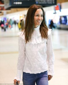 Earlier in the day the new bride was pictured leaving Sydney on Thursday morning - despite yesterday's activities, she was full of smiles