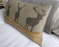 """Hand printed in Wiltshire inspired by The Highlands, our Great parks and Celtic mythology and the Jura Forests, called """"the cromie stag,"""" Gaelic for """"crooked."""" In Jura only do these stags exist; how they got there or whence they came no one knows, but there they have been from time immemorial, and confident I feel either that they are a distinct race, or that some stag from foreign lands once managed to get to Jura in days gone by   This is a magestic rustic cushion based on a white stag…"""