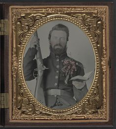 Private David Lowry, of Company E, 25th Virginia Cavalry Regiment, Company A, 41st Virginia Infantry Regiment, and Company D, 47th Virginia Infantry Regiment, in uniform and corsage of flowers with musket and book] (LOC) by The Library of Congress