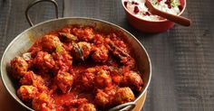 Lamb sausages become quick and easy meatballs in this hearty Sunday night curry.