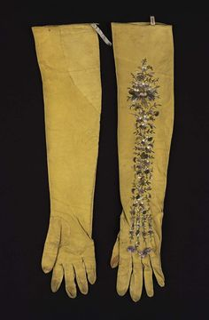 Pair of women's kid gloves | Pair of soft, yellow, leather gloves. Design: small flowers embroidered on back of each hand and arm in satin stitch, etc., with pale lavender, green, and cream-colored silk. Stained. (Collection Achille Jubinal 21). Museum of Fine Arts, Boston