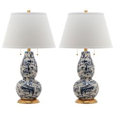 """Emulating classic marble, the Color Swirls table lamp offers artistic modern style. Metallic gold accents complement this light fixture's contemporary blue and white painted design. Set of 2; 100% white cotton tapered cone shade; Accepts one 100-watt bulb (not included); Screw terminal bulb base; Traditional harp; Gold finial; On/off switch; Wipe down with soft, dry cloth; 17""""W x 17""""D x 28.5""""H; Shade: 17"""" Dia x 11""""H; Bottom base: 7"""" Dia x 1""""H; Cord: 61""""H"""