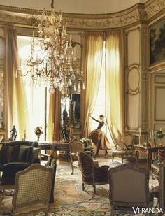 A large tiered chandelier hangs over the salon in Hubert de Givenchy's Paris residence, circa 1990. - Veranda.com