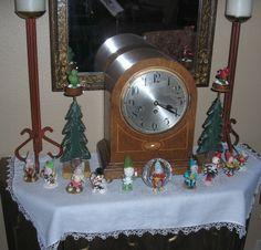 Vintage elf figures rally around an old clock