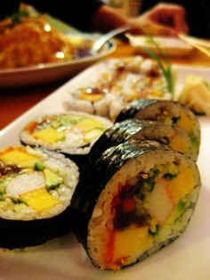 Futomaki Sushi (A thick roll containing multiple ingredients. Common ingredients include egg, kanpyo, cucumber and mushrooms.)