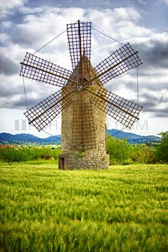 Check the Majorcan windmills.Mallorca - Old grain mills and wind-powered water pumps are the island's landmarks. some of them rebuilt and adapted to make a cozy home. Menorca, Tilting At Windmills, Old Windmills, Balearic Islands, Spain And Portugal, Water Tower, Le Moulin, Covered Bridges, Spain Travel