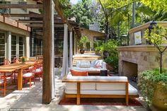 The couple have an outdoor kitchen at the home, as well as a eight-person dining table that sits across from a fireplace