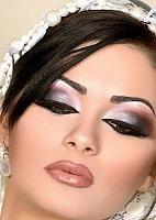 Unique Arabic bridal make up in grey, red color