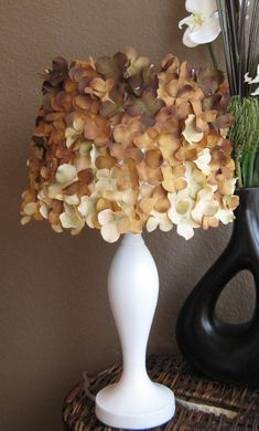 Easy cute lamp shade, looks like all you need is a fake hydrangea flower and glue it on!  doing it this weekend!