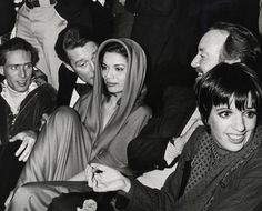 At Studio 54's first Anniversary party in 1978 with designer Halston, Liza Minnelli and her husband, Jack Haley Jr. Jagger's hooded dress by Halston