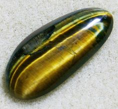 Tiger Eye Cabochon  Exquisite with a Touch of by JewelryArtistry