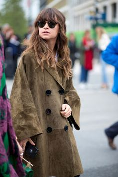 The perfect fall layering piece? The oversized suede coat, as seen on Miroslava Duma. See 100+ inspiring street style outfits on BAZAAR: