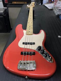Here's a JB in Fullerton Red over Empress, 3-ply creme guard, maple neck with Vintage Tint Satin finish. CLF078115 is headed to G&L Premier Dealer Performance Music Center in Woburn, Massachusetts. G&L Musical Instruments