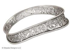 Intricately designed, this Sterling Silver, oval-shaped, wavy Bangle is perfect for stacking or wearing as a solo stunner.