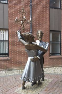 'Dancers (A Quick Step to Recovery)' - Ipswich, Suffolk, England;  one dancing couple (of two) in the courtyard of South Ward Ipswich Hospital;  made by sculptor Paul Richardson