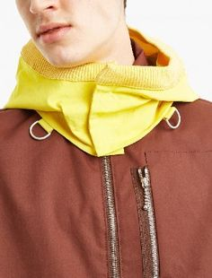 OAMC Brown Windbreaker with Detachable Hood The OAMC Windbreaker with Detachable Hood for SS17, seen here in brown and yellow. - - - Crafted in Italy from premium cotton and cut to offer a relaxed fit, this classic windbreaker from OAMC is upda http://www.MightGet.com/january-2017-13/oamc-brown-windbreaker-with-detachable-hood.asp
