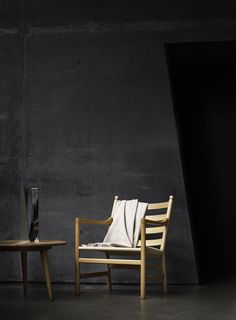 Dark walls can really make furniture stand out as shown here with Carl Hansen's beautifully crafted chair and coffee table,   Coffee table CH008 by Hans J Wegner