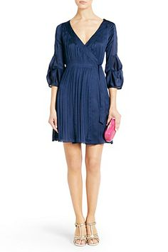 Sawyer Pleated Wrap Dress In Deep SeaA classic wrap style with a silky smooth texture, the Sawyer dress transitions effortlessly into Fall. With 3/4 sleeves and pleating detail. Lined through bodice. Fit is true to size. Falls to above knee.