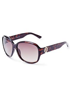 83f7381ebb A round oversized design and rhinestone-embellished logo make these GUESS  sunglasses the pair-