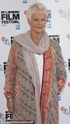 The many scarves of Judi Dench (- the colours she is wearing are soft, but combined with the patterns, make this a super outfit. - Fi)