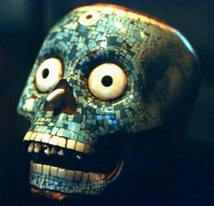Aztec-decorated skull at the National Museum of Anthropology, Mexico City.