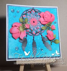 Made by Femke Niessen: Designer of the month MD card #5 dreamcatcher with roses. Made the roses  in 3d by creating more layers.  Used the dreamcatcher and the build a rose from Marianne Design.