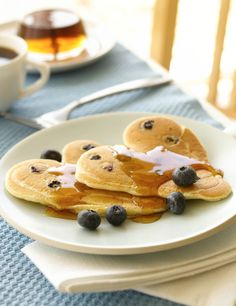 "Bisquick Heart Smart® recipe! Blueberry pancakes can be delicious and ""love-ly"" with easy heart shaping."