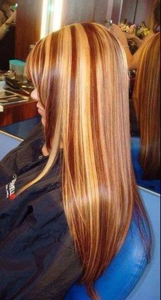 Golden Blonde Hair With Reddish Caramel Lowlights By