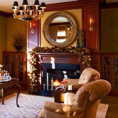 """""""The classic library, complete with built-in bookcases, exhibits a striking, dark-hued holiday garland on the mantel."""" Catherine and Peter Malone's 1910 Colonial Revival house in Milton, Massachusetts. Floral design: Daniel Lopez-Ospina and Jeb Taylor, New Leaf Flores. Interior design: Gerald Pomeroy. Photo: Bruce Buck. Text by Krissa Rossbund. """"Colorful Christmas in a Colonial"""" produced by Estelle Bond Guralnick. Traditional Home."""