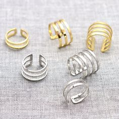 This minimal stacking ring set has got you covered when it comes to fashion accessories! A mixture of six adjustable rings in gold and silver makes this a versatile set! - Set of 6 (3 gold + 3 silver)
