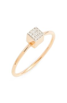 Currently crushing on this contemporary ring that showcases a slender 18-karat band and a geometric setting dusted with diamonds.