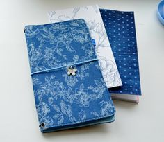 Cover fabric Midori notebook.  Made with pretty designer cotton fabric and super sturdy interfacing inside for stability and thickness. This delightful cover will be with you for a very long time. Sizes:  IN STOCK ONLY - Regular/Standart size cover - suitable for the - 8.5 x 4.5 inch notebooks (perfect for Regular/Travelers Size Midori notebooks)   *Notebook inserts are NOT included. Notebooks are held in with a thick, sturdy elastic. The notebook cover is held closed with the same elastic…