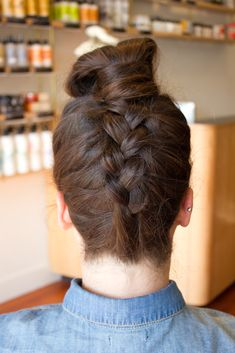 """Give Tired Buns A Twist With These 4 Fresh Styles""  http://www.refinery29.com/31694#slide-1  Look 1: Upside Down Braid Bun  Photographed by Christine Ting"