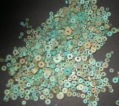 Turquoise beads recovered from early excavations at Pueblo Bonito, the largest great house in Chaco Canyon.