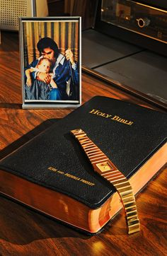 Elvis Presley's Rolex King Midas, Bible and picture on display at Graceland.