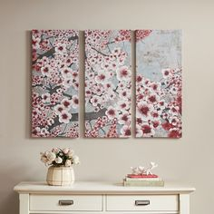 Gleeful Blossoms Wine will add serenity to any room. This three panel set is printed on canvas with hand painted embellishments to add an artistic touch. Artist: Norm Wyatt Jr.
