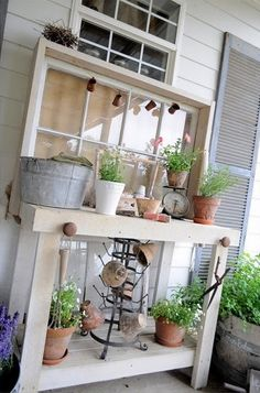 source   See just an old table makes a great potting bench.     source   But here is one made out of pallet wood.   I guess I could roam ...