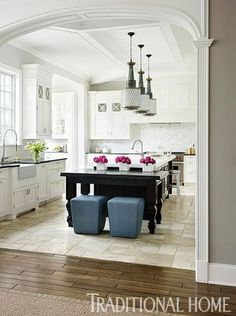 Lovely arched moulding into kitchen. Also good example of wood to tile…