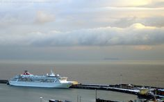 MS Balmoral Cruise Ship and snow-covered Admiralty Pier, Dover Harbour, Kent, England, UK. Zoom photo of the English Channel from the Western Heights. Passenger ship owner Fred Olsen Cruise Lines: Call Sign C6II4, IMO 8506294, MMSI 308785000. Ex-Crown Odyssey, Norwegian Crown. December 19th, 2009, prior to leaving on a 2 night mini-cruise to Amsterdam, Holland (Netherlands) for Christmas shopping. Winter Port of Dover travel, tourism, and vacation. See: http://www.panoramio.com/photo/3018628...