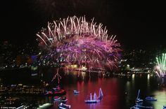 The midnight fireworks appear like lightning from Sydney Harbour Bridge in this electrifyi...