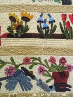 We Plant the Seeds by Julia Spalla, quilted by Barbara Angerhofer.  Design by Primitive Gatherings.  Photo by Quilt Inspiration