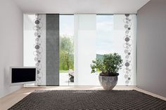 The Carat_24 Panel Blind fabric collection features 156 materials in 19 different weaves. Aluminum hardware available in Silver and White as well as a Brushed finish.