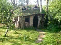 truly, a breathtakingly brilliant playhouse for the girls AND me--i officially declare this to be our family's first real outdoor project that I hope will provide wonderful memories and a backyard retreat for us as well as generations ahead (Log House 2009 by J0_M0, via Flickr)
