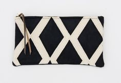 A large black + white hand painted diamonds zip clutch with a METAL zipper. Made by Hanks Shop, for $45.00.
